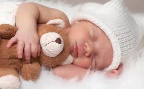 sleeping baby with teddy
